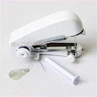 Wholesale 2014 New Novetly Mini Clothes Sewing Machine Portable Convenient Home Travel Use Handheld Sewing Machine