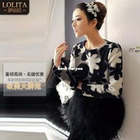 Wholesale European Grand Prix autumn and winter new women in Europe and America retro hit color stitching long sleeved woolen jacket ostrich feat