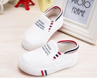 Wholesale Feiyao shoes four seasons low uppers men lazy leisure children set foot a solid color canvas shoes