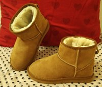 Wholesale fashion brand new womens real lwather snow boots mini short style winter boots retail