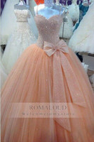 Pêcheresse de fête Prix-Custom Made 2017 Peach Puffy Ball Gown Sequined Spaghetti Straps Tulle Plissé Sweetheart Quinceanera Pageant Party Gown Formal Prom Dresses