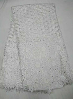 Wholesale High class apparel material in white guipure lace with stones chemical cord lace fabric for evening dress CWZ2 yards