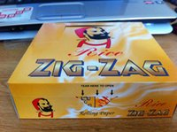Cheap ZIG-ZAG SIZE 70mm*36mm cigarette rolling paper 50 booklets a box 100 papers a booklet for 70mm rolling machine grinder glass bong hot