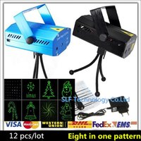 Wholesale 12pcs Eight in one pattern Optional design Mini Laser Stage Light mW Mini Green Red Laser DJ Party Lighting Disco Dance Floor Lights