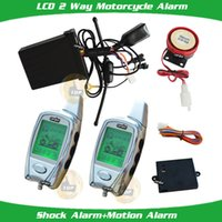 Wholesale new silver motorbile alarm two way LCD alarm remote microwave sensor motion alarm trigge shock alarm LCD remote vibration and audible hints