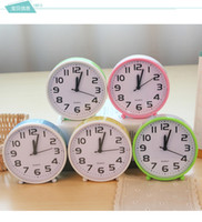 Wholesale multi color quartz alarm clock candy colored creative alarm clock desktop clock small round shaped alarm clock