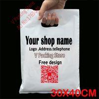 al por mayor logotipo bolsa de plástico paquete-Al por mayor-30 * 40cm personalizados bolsas de plástico de impresión de embalaje bolsa de regalo para la ropa de compras logo portadora mango marca diseñada bolsas de PE mayorista