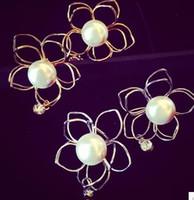 Wholesale gold silver hollow flower pearl women s earings xcdxl
