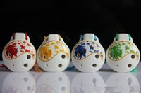 Wholesale Jingdezhen Ceramic genuine Xinli hole flute alto ocarina Taiji four color flower delivery simple textbook