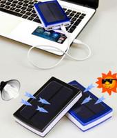Dual USB solaire chargeurs de batterie haute capacité 30000mAh Portable Solar Energy Panneau Chargeur Power Bank For Mobile Phone Pad Tablet MP4 Ordinateur portable