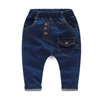 Wholesale autumn and winter Korean version boys letters print fashion jeans long pants casual large crotch harem pants KZ