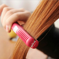 Wholesale Hot Sale Portable Mini Ceramic Hair Curl Straightener Flat Iron Perm Splint Hair Care Styling Tools