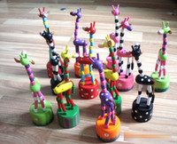 Wholesale 2015 Baby Wooden Rock Giraffe Toy Standing Dancing Hand Doll cm Tall Animal Toy Kid V15032304