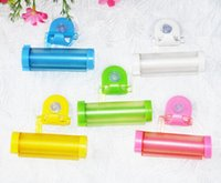 Wholesale Creative Rolling Squeezer Toothpaste Dispenser Tube Partner Sucker Hanging Holde