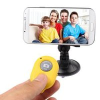 Wholesale 100 Brand New Wireless Camera Bluetooth Remote Shutter For iPhone HTC Samsung Sony IOS