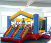 Wholesale YARD cheap nylon bounce house inflatable bouncer combo dual slide moonwalk with blower