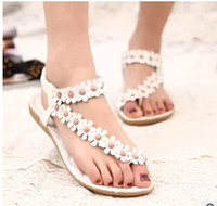 Wholesale 2015 Bohemia women s sandals pinch the new summer flowers flat toe shoes Korean with flat sandals