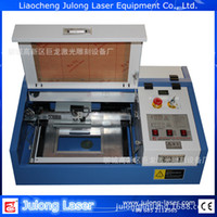 Wholesale Small laser engraving machine dragon laser engraving machine laser cutting plotter Professional engraved chapter machine