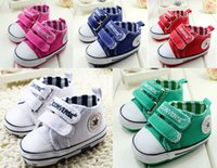 Wholesale Solid fall newborn girl tie with soft bottom canvas toddler shoes Indoor sports baby children walking shoes baby wear pair CL
