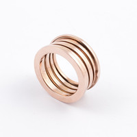 asian fashion brands - Fashion brand yellow k gold plating L stainless elastic spring finger rings jewelry for men and women SR00604