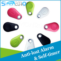 Wholesale Hot sale Bluetooth Anti Lost Alarm Tracer Remote Camera Shutter IT iTag Anti lost tracker Self timer bluetooth for Android IOS