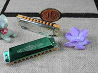 Wholesale Ciling instruments hole harmonica playing Rainbow series of senior level manufacturers