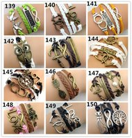 Wholesale 283 Designs Leather Bracelet Antique Cross Anchor Love Peach Heart Owl Bird Believe Pearl Knitting Bronze Charm Bracelets C2182