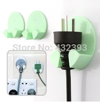 electrical plugs and sockets - Paste type electrical plug socket mounted hook and practical storage rack