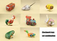 Wholesale Tin clockwork toy frog living eye frog green jump baby toys cock rabbit duck Locomotive wind up toys train
