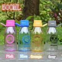 Vente en gros 4pcs / lot, bouteille de bouteille d'eau de 500ML pour enfants Coupe d'espace plastique portative pour enfants Livraison gratuite 4 modèles disponibles