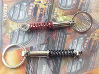 Cheap Creative Hot Shock Absorbers Keychain Auto Parts Key Chain Ring Bumper Key Fob Fashion Keyring