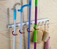Wholesale 8 Positions Wall mounted mop holder Household sundries storage holder Kitchen rack