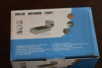 Wholesale Hot Wireless white color W v LED Solar Motion Sensor Light Outdoor Wall Garden Lamp