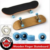 wholesale novelty items - 2015 Professional Maple Wood Finger Skateboard Nickel Alloy Stents Bearing Wheel Fingerboard Adult Novelty Items Children Toys a945