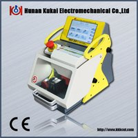 Yellow and off-White key cutting machine - CE Approved Widely Used Automatic Computerized Modern Duplicate Key Code Cutting Machine SEC E9 Car Key Copy Machine
