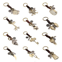 Wholesale 13 Style Vintage Braid Genuine Leather Key Chain Owl Minions Conch Pendant Keyring Men Women Lover Key Chains Fine Jewelry DCBJ921