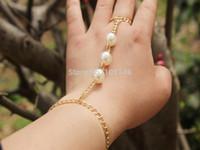 Wholesale 2015 NEW gold slave hand chain Fashion Celebrity big Pearl bracelet Bangle with finger hand jewelry adjustalbe good quality