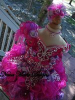 cupcake pageant dresses - 2015 Cute Ball Gown Girl s Glitz Pageant Dresses Hand Made Flowers Beads Crystals Feathers Cupcake Organza Wedding Flower Girls Dresses