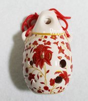 Wholesale Xinli holes treble C tune of blue and white tin whistle Binglie variety of porcelain ocarina flute Andy