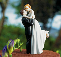 Wholesale Romantic Wedding Cake Toppers The Groom Is Lifting His Bride In A Loving Embrace Hand Painted Polyresin Couple Figurine
