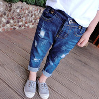 women jeans wear - 2015 new winter Korean boy pants worn trousers for men and women children s children washing hole hole jeans