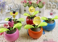 Wholesale 48pcs Solar Powered Flip Flap Flower Cool Car Dancing Toys