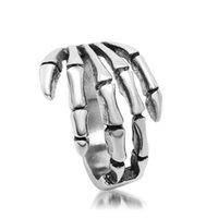 al por mayor joyas de titanio-Joyería Nuevo anillo retro de la joyería que canta el anillo Titanium de la mano del cráneo punky SA085