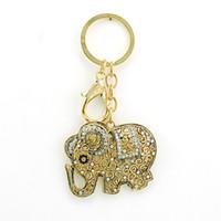 Белых слонов Цены-Мода покрытием золото брелоков Выдолбленный Белый Rhinestone ретро слон очаровывает фермуар омара брелок автомобиля вешалка для украшений