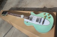 Wholesale Chinese musical Instruments Factory custom new Rosewood fingerboard Light green electric guitar Corvette guitar