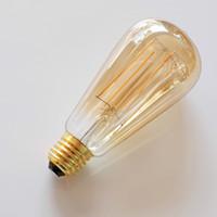 Largo Filamentos Ámbar Tinte Led filamento de la bombilla de Dimmable 4W 6W jaula de ardilla antiguo Edison Iluminación E27 B22 E26 Blanco Cálido Lámpara decorativa