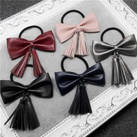 Wholesale Korean version of the latest rubber band PU leather bow tassel honey beans retro rubber band hair rope Tousheng hair accessories