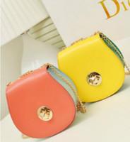 Wholesale Hit color small lock new handbag small fresh hit color semicircle turn lock shoulder bag Messenger bag