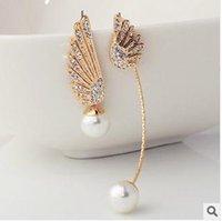 Wholesale 2015 elegant pearl earrings gold at the end of asymmetric wings zirconium earrings diamond earrings jewelry strange new