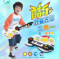Wholesale Early childhood educational toys multifunctional lighting simulation of electric guitar guitar music electronic piano toy